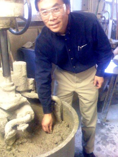 C.P. Bok at the concrete mixer, whipping up a test batch.