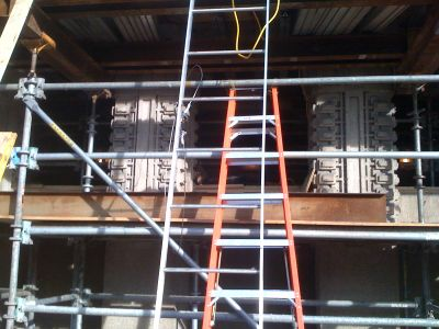 Shoring supports the underside of the cantilevered portion of the roof.