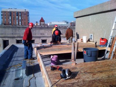 Zera Construction builds a temporary roof structure.